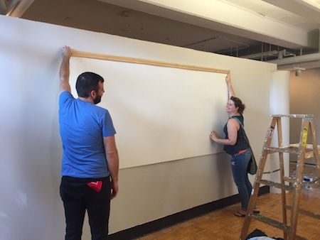 Hanging whiteboards.