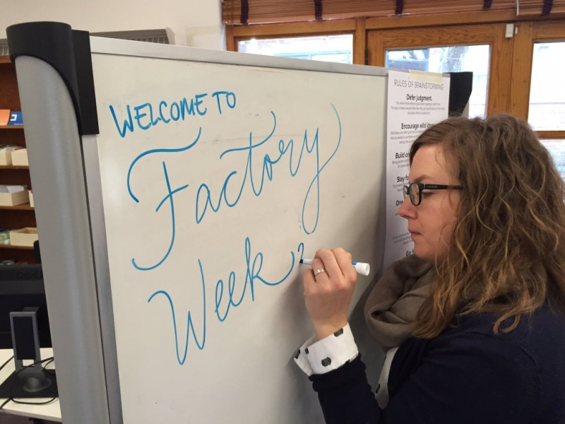 Lydia making a Factory Week sign